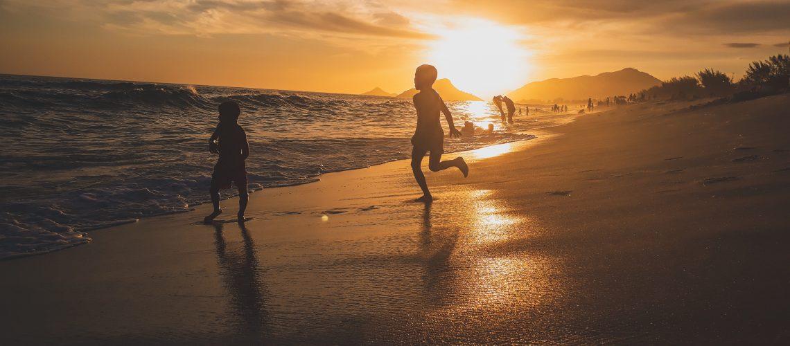 beach-children-clouds-1766535-cropped